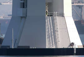 A maintenance worker walks on the base of the eastern Bay Bridge tower, whose elevator has been inoperable for a month.