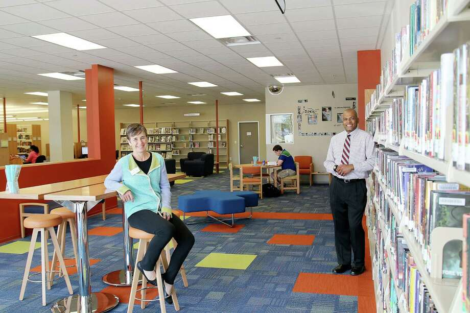 Westside Branch Librarian Sue Wheeler and library director David Thrash say added space has enabled expansion of Westside services. Photo: Pin Lim, Freelance / Copyright Forest Photography, 2015.