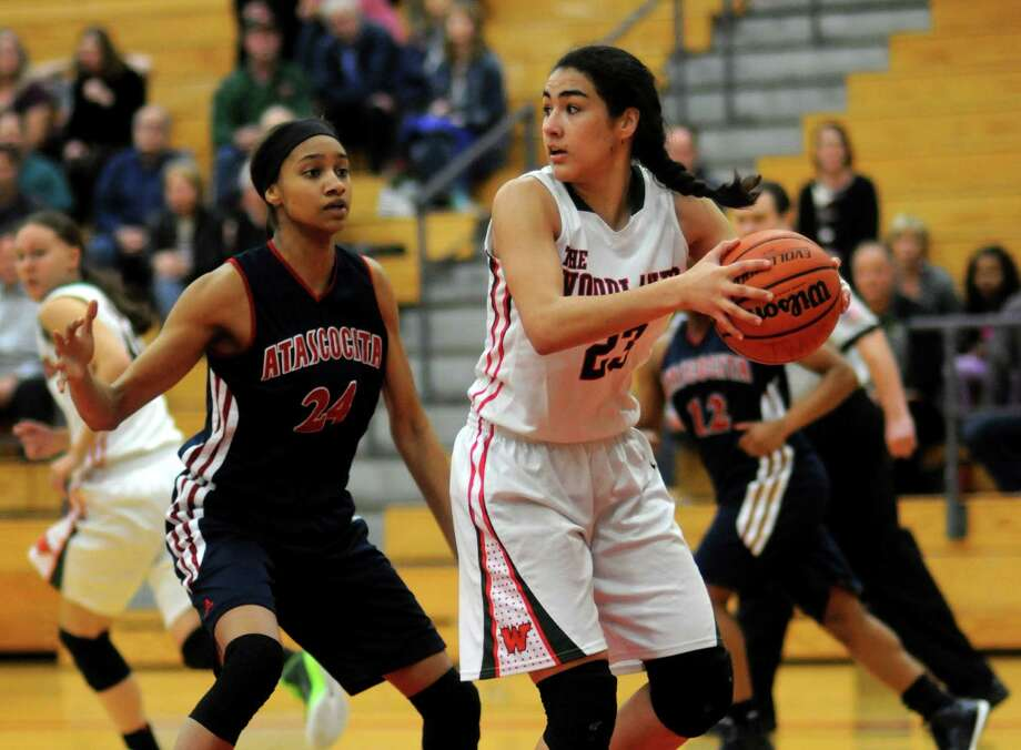 The Woodlands forward Luisa De La Rosa, right, has been a key part of the Highlanders' postseason run this season. Photo: Jerry Baker, Freelance