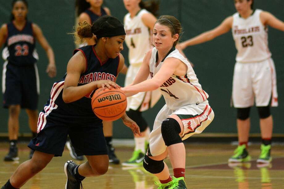 Atascocita's Aimee Brown, left, works the ball against The Woodlands junior Meghan Musso during the Eagles' surprising loss last week. Photo: Jerry Baker, Freelance