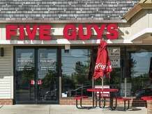 MOUNT LAURAL, NEW JERSEY, UNITED STATES - 2014/08/28: Five Guys restaurant exterior.
