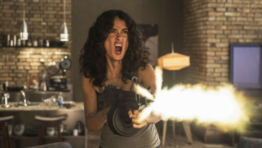 """""""Everly"""": Salma Hayek has a very bad night in this ersatz Tarantino action flick, which has an abundance of blood and gore and a couple of laughs. She's a sex slave trapped in a prisonlike apartment house who, in short order, has to contend with gun-wielding prostitutes, dapper gangsters, a bad dog, a visit from her mom (!), a paramilitary squad, a sadist named The Sadist and, finally, her vengeful master. Somewhat more intense than the big fight in """"Grown Ups 2."""" (Available to buy or rent before theatrical release.) Photo: /Radius-TWC / photoA.Letic"""