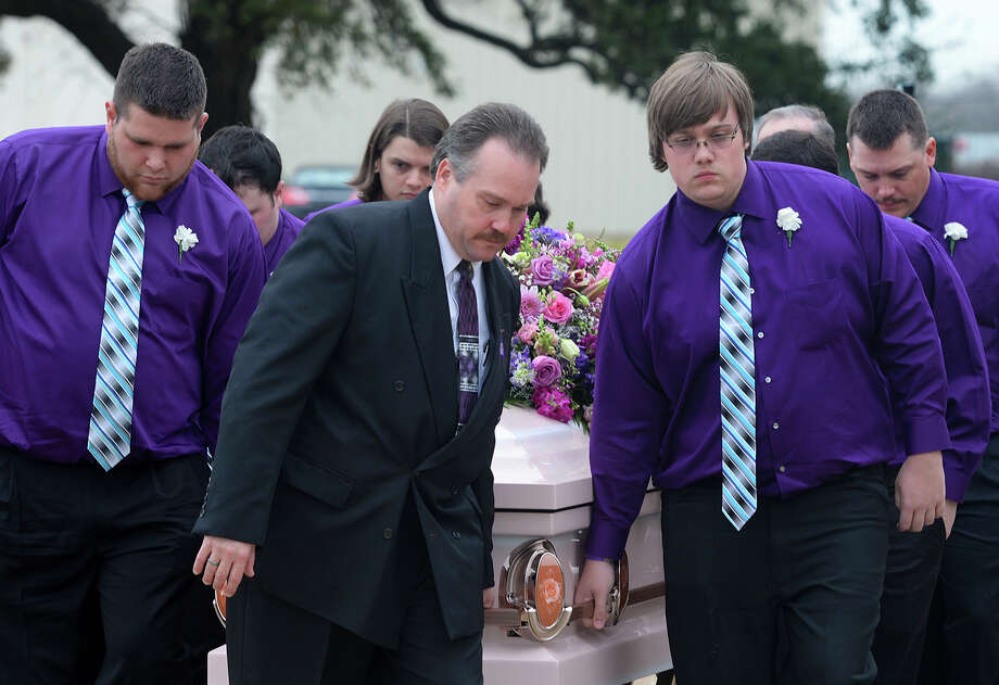 Pallbearers exit  Encounter Church with Kristin Paris's casket after Tuesday's funeral services. Paris died from injuries from a January car accident.   Photo taken Tuesday, February 03, 2015 Guiseppe Barranco/The Enterprise Photo: Guiseppe Barranco, Photo Editor