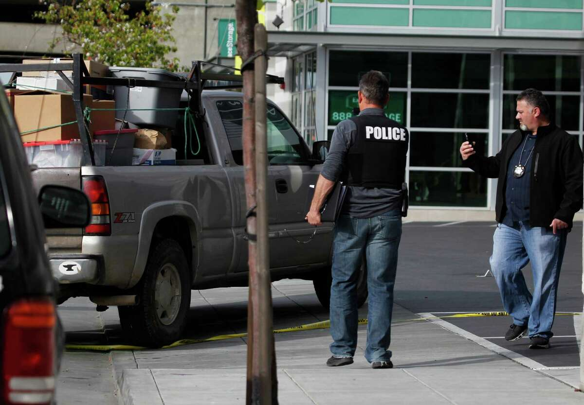 Police officers from Oakland and Emeryville investigate an officer-involved shooting on Hollis Street near 34th Street in Oakland on Tuesday.