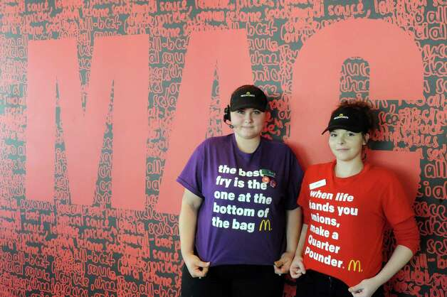 Crew trainer Samantha Ferguson, left, and crew member Amber Chiera wear merchandising T-shirts as part of the  a€œLovina€™ Acta€ campaign at McDonald's on Tuesday Feb. 3, 2015 in Waterford, N.Y. McDonalda€™s is now accepting Lovina€™ as a form of currency. With the launch of McDonalda€™s a€œPay with Lovina€™a€ Super Bowl commercial, the company is bringing the idea to life at participating restaurants across the U.S. Some lucky customers in the New York Capital Region as well as restaurants in the Berkshires of Massachusetts and select regions in Western Vermont, will be selected through a randomized process at predetermined times and engaged to pay with a Lovina€™ act instead of money. (Michael P. Farrell/Times Union) Photo: Michael P. Farrell / 00030430A