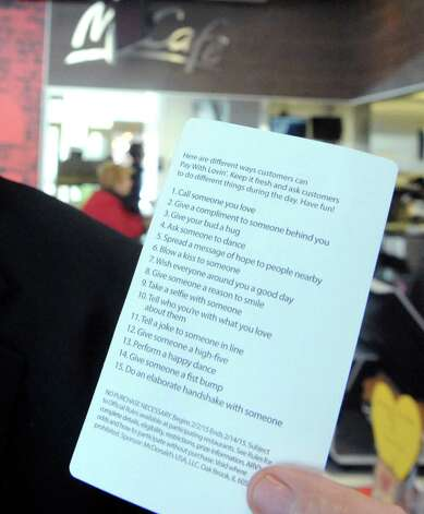 Owner/operator Roger Grout holds the list of loving acts associated withe the a€œLovina€™ Acta€ campaign at McDonald's on Tuesday Feb. 3, 2015 in Waterford, N.Y. McDonalda€™s is now accepting Lovina€™ as a form of currency. With the launch of McDonalda€™s a€œPay with Lovina€™a€ Super Bowl commercial, the company is bringing the idea to life at participating restaurants across the U.S. Some lucky customers in the New York Capital Region as well as restaurants in the Berkshires of Massachusetts and select regions in Western Vermont, will be selected through a randomized process at predetermined times and engaged to pay with a Lovina€™ act instead of money. (Michael P. Farrell/Times Union) Photo: Michael P. Farrell / 00030430A
