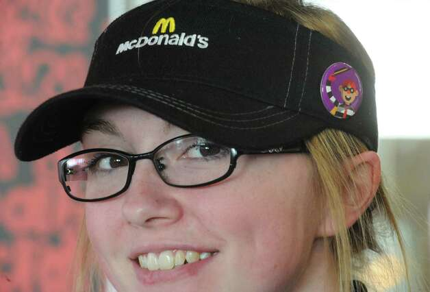 Crew member Brooke Turcotte smiles as she works the counter during a day of the a€œLovina€™ Acta€ campaign at McDonald's on Tuesday Feb. 3, 2015 in Waterford, N.Y. McDonalda€™s is now accepting Lovina€™ as a form of currency. With the launch of McDonalda€™s a€œPay with Lovina€™a€ Super Bowl commercial, the company is bringing the idea to life at participating restaurants across the U.S. Some lucky customers in the New York Capital Region as well as restaurants in the Berkshires of Massachusetts and select regions in Western Vermont, will be selected through a randomized process at predetermined times and engaged to pay with a Lovina€™ act instead of money. (Michael P. Farrell/Times Union) Photo: Michael P. Farrell / 00030430A