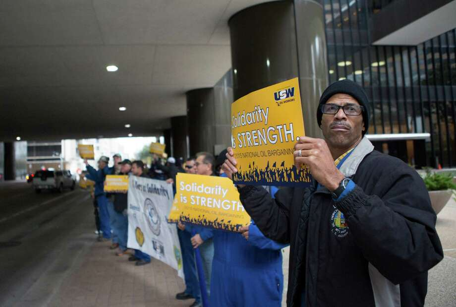 """L.C. Jackson pickets with other United Steelworkers union members in front of the LyondellBasell Tower in February. Workers will vote this week on an amended version of what LyondellBasell had called its """"last, best and final"""" offer. Photo: Cody Duty, Staff / © 2014 Houston Chronicle"""