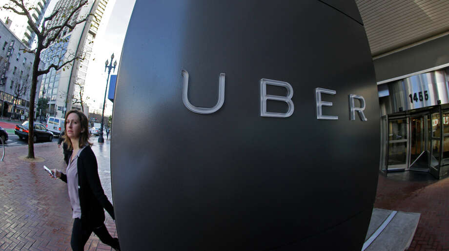 Uber has more than 20,000 drivers in the Bay Area, but it says they are independent contractors, not employees. Photo: Eric Risberg / Associated Press / AP