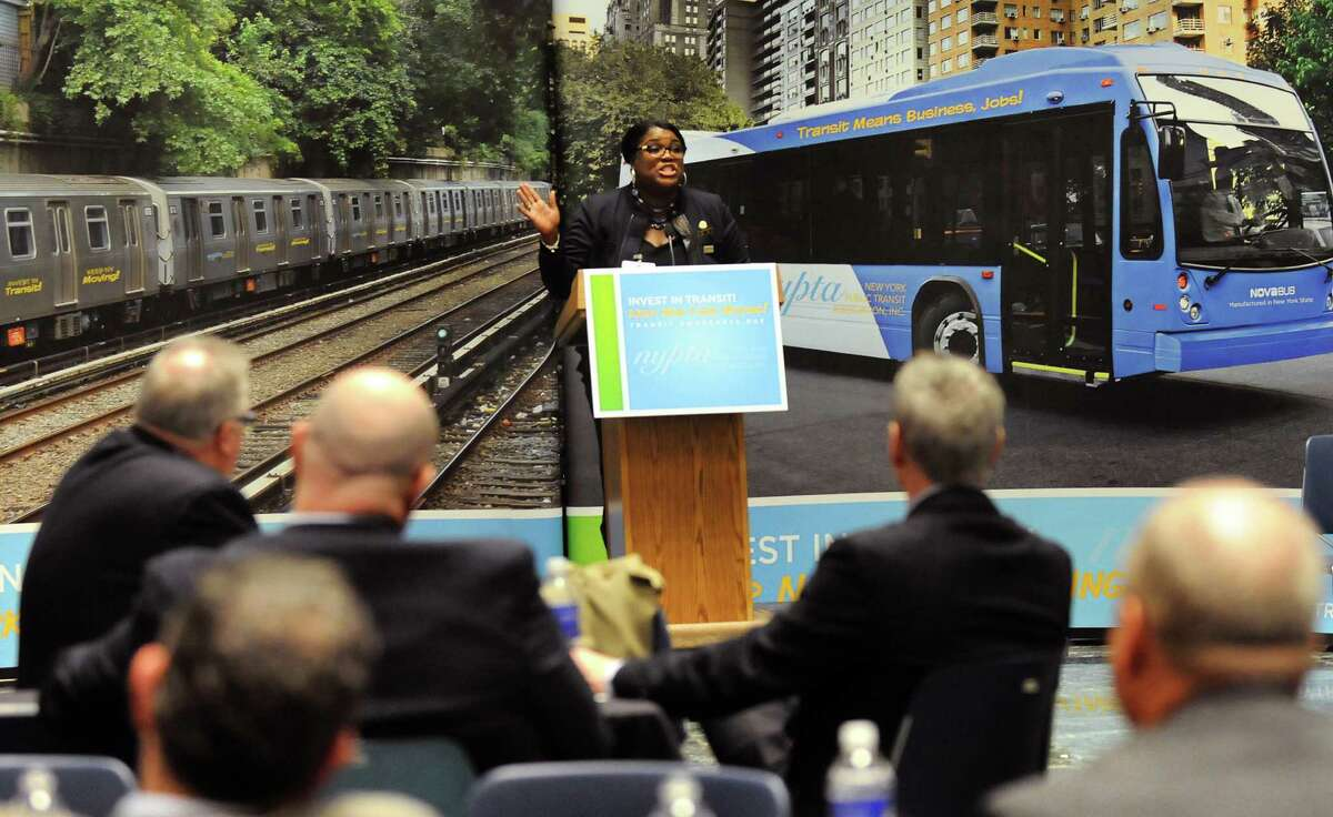 Latonya Crisp-Sauray, a bus driver in New York City, center, speaks about investing in public transportation on Tuesday, Feb. 3, 2015, at the Legislative Office Building in Albany, N.Y. (Cindy Schultz / Times Union)