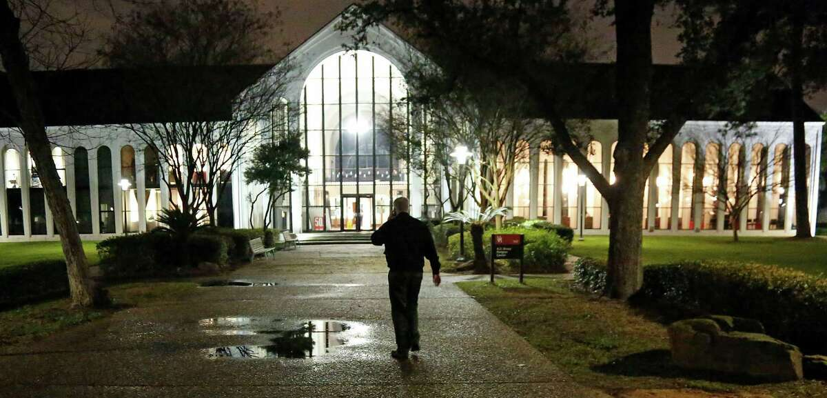 A man arrives for a prayer service in honor of slain Episcopal priest Israel Ahimbisibwe, his wife and 5-year-old son. The service was held Tuesday evening at the University of Houston.