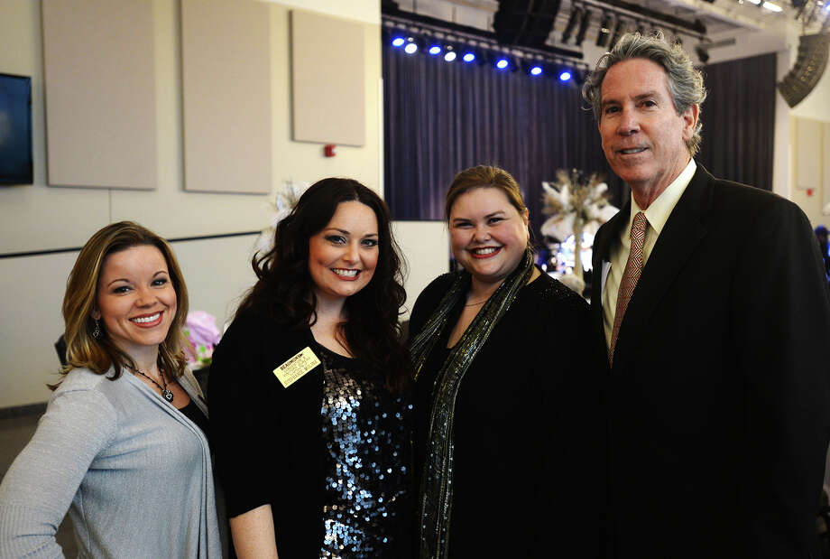 Ashley White, Stephanie Molina, Elizabeth Eddins, and Dean Conwell, left to right, pose for a photo Tuesday night. The Event Centre hosted the Beaumont Convention and Visitors Bureau's Hall of Fame Reception on Tuesday night.  Photo taken Tuesday 2/3/15 Jake Daniels/The Enterprise Photo: Jake Daniels / ©2014 The Beaumont Enterprise/Jake Daniels