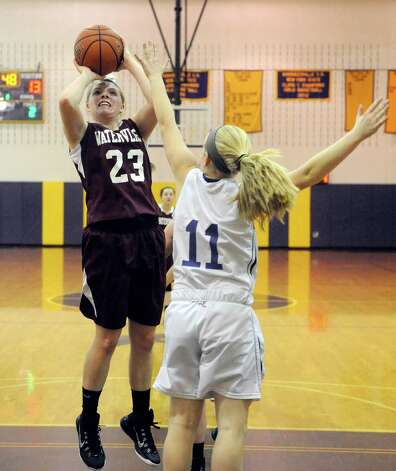 Watervliet's Kaila DeLoriea drives to the basket defended by Voorheesville's Emily Burke during their girl's high school basketball game on Tuesday Feb. 3, 2015 in Voorheesville, N.Y. (Michael P. Farrell/Times Union) Photo: Michael P. Farrell / 00030437A