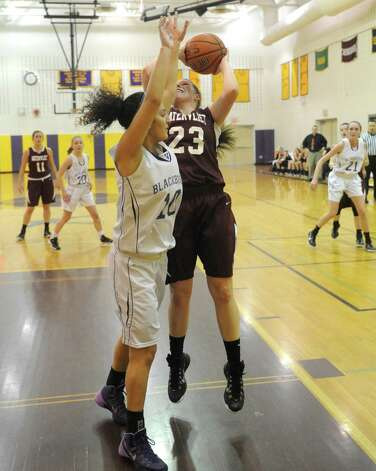 Watervliet's Kaila DeLoriea drives to the basket defended by Voorheesville's Laura Patak during their girl's high school basketball game on Tuesday Feb. 3, 2015 in Voorheesville, N.Y. (Michael P. Farrell/Times Union) Photo: Michael P. Farrell / 00030437A