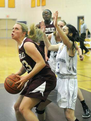 Watervliet's Kaila DeLoriea drives to the basket during their girl's high school basketball game against Voorheesville on Tuesday Feb. 3, 2015 in Voorheesville, N.Y. (Michael P. Farrell/Times Union) Photo: Michael P. Farrell / 00030437A