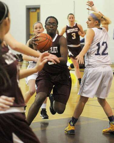 Watervliet's Ali Changa drives to the basket during their girl's high school basketball game against Voorheesville on Tuesday Feb. 3, 2015 in Voorheesville, N.Y. (Michael P. Farrell/Times Union) Photo: Michael P. Farrell / 00030437A