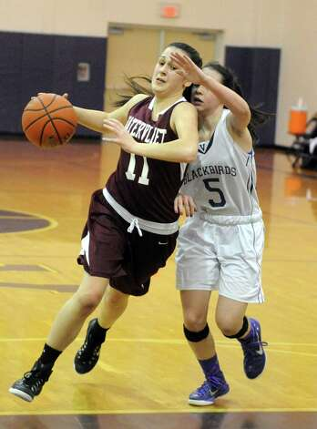Watervliet's Meghan Capone brings the ball down court defended by Voorheesville's Rebecca Clair during their girl's high school basketball game on Tuesday Feb. 3, 2015 in Voorheesville, N.Y. (Michael P. Farrell/Times Union) Photo: Michael P. Farrell / 00030437A