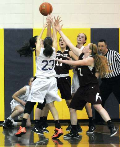 Watervliet and Voorheesville players battle for a rebound during their girl's high school basketball game against on Tuesday Feb. 3, 2015 in Voorheesville, N.Y. (Michael P. Farrell/Times Union) Photo: Michael P. Farrell / 00030437A
