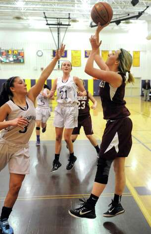 Watervliet's Kiki Szezepanski  puts up a shot during their girl's high school basketball game against Voorheesville on Tuesday Feb. 3, 2015 in Voorheesville, N.Y. (Michael P. Farrell/Times Union) Photo: Michael P. Farrell / 00030437A