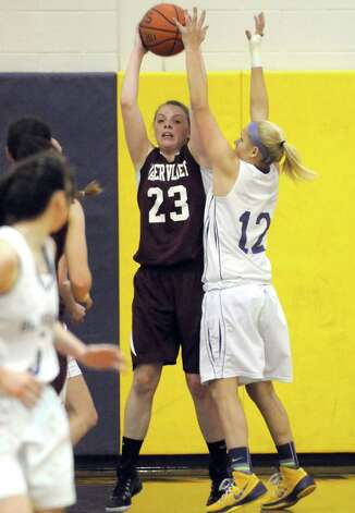 Watervliet's Kaila DeLoriea looks to pass during their girl's high school basketball game against Voorheesville on Tuesday Feb. 3, 2015 in Voorheesville, N.Y. (Michael P. Farrell/Times Union) Photo: Michael P. Farrell / 00030437A