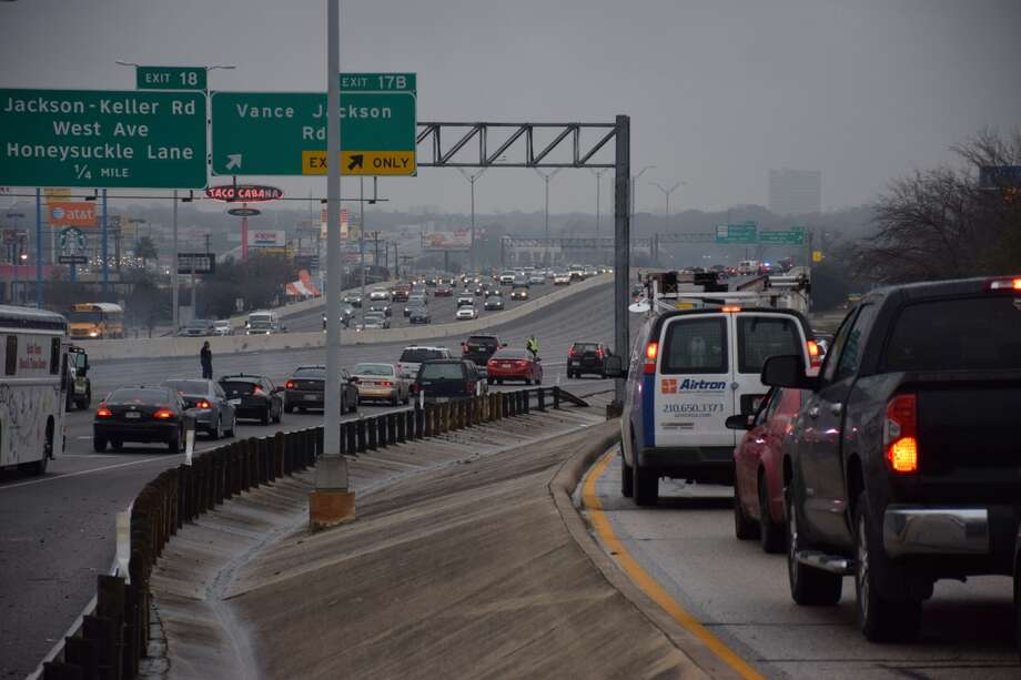 The eastbound lanes of Loop 410 have been shut down near Jackson Keller while crews work to clear the scene of multiple accidents. Photo: By Mark D. Wilson/San Antonio Express-News