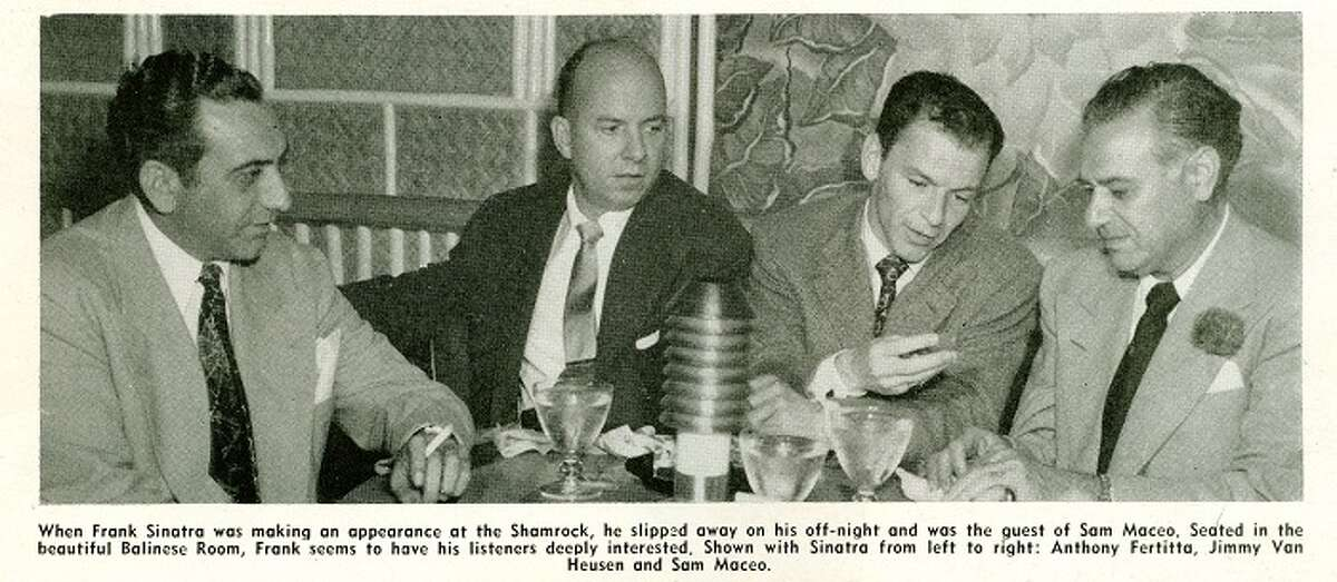 Sam Maceo, who historians say was a leader of Galveston's Maceo crime syndicate, sits with entertainer Frank Sinatra. The family operated the Balinese Room, a casino shut down by the Texas Rangers. (Courtesy of the Rosenberg Library)