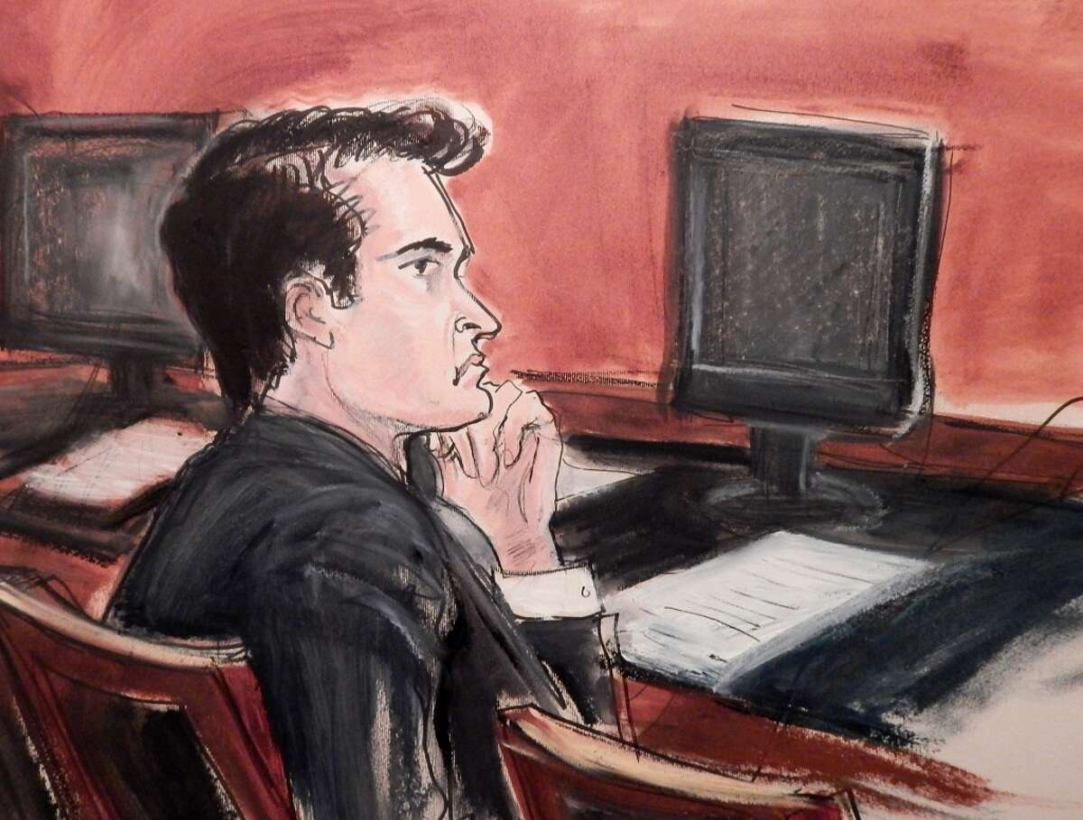 Ross Ulbricht listens to proceedings from the defense table during his criminal trial in New York. (AP Photo/Elizabeth Wlliams)