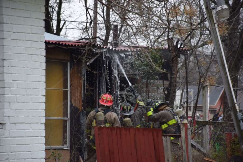 At least 10 San Antonio fire crews responded to a blaze just after 10 a.m. on Wednesday in the 7500 block of Somerset Road. Photo: Mark D. Wilson/San Antonio Express-News