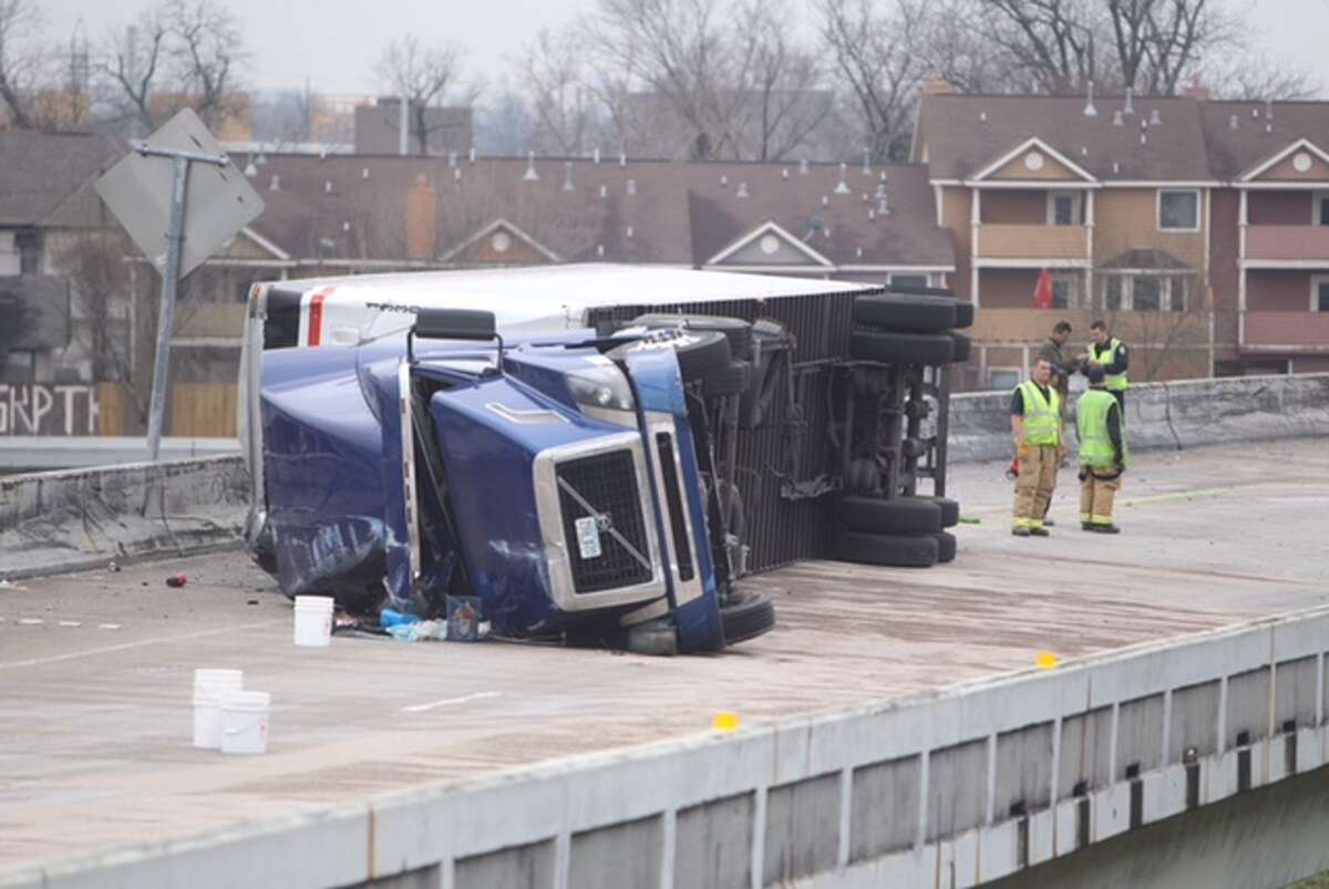 An overturned big rig filled with car batteries shut down US-59 East near downtown Houston on Feb. 4, 2015 and caused a call out for Hazmat cleanup crews.