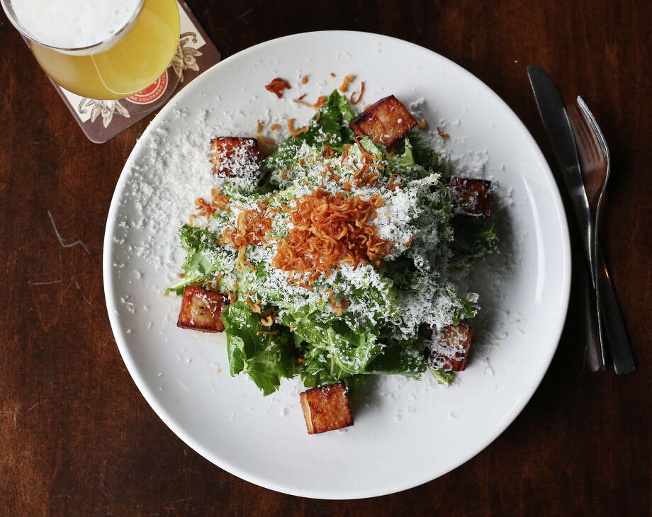 "The baby kale salad comes with pork belly ""croutons,"" Parmigiano-Reggiano, and fried shallots at The Hoppy Monk, Tuesday, Feb. 3, 2015. The establishment is located off Loop 1604 in the Stone Oak area. Photo: Jerry Lara /San Antonio Express-News / © 2015 San Antonio Express-News"