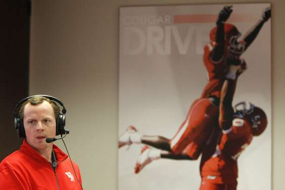 University of Houston's Major Applewhite, Offensive Coordinator/Quarterbacks speaks during a webcast as head football coach Tom Herman signed his first class in the war room at UH, Wednesday, Feb. 4, 2015, in Houston.  ( Karen Warren / Houston Chronicle  )