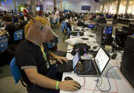 A man wears a horse mask during the Campus Party technology festival in Sao Paulo, Brazil, Tuesday, Feb. 3, 2015. Campus Party is an annual week-long, 24-hour technology festival that gathers hackers, developers, gamers and computer enthusiasts.