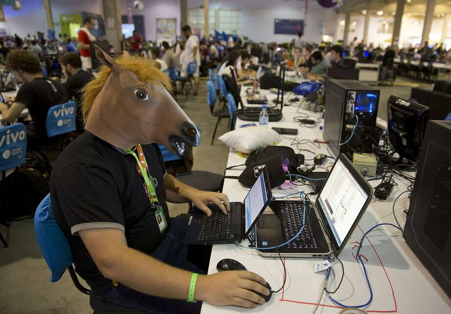 WAY TO PENETRATE THAT FIREWALL, SEABISCUIT:Campus Party is a week-long, round-the-clock technology festival in Sao Paulo that gathers hackers, developers, gamers and computer enthusiasts, some incognito. Photo: Andre Penner, Associated Press