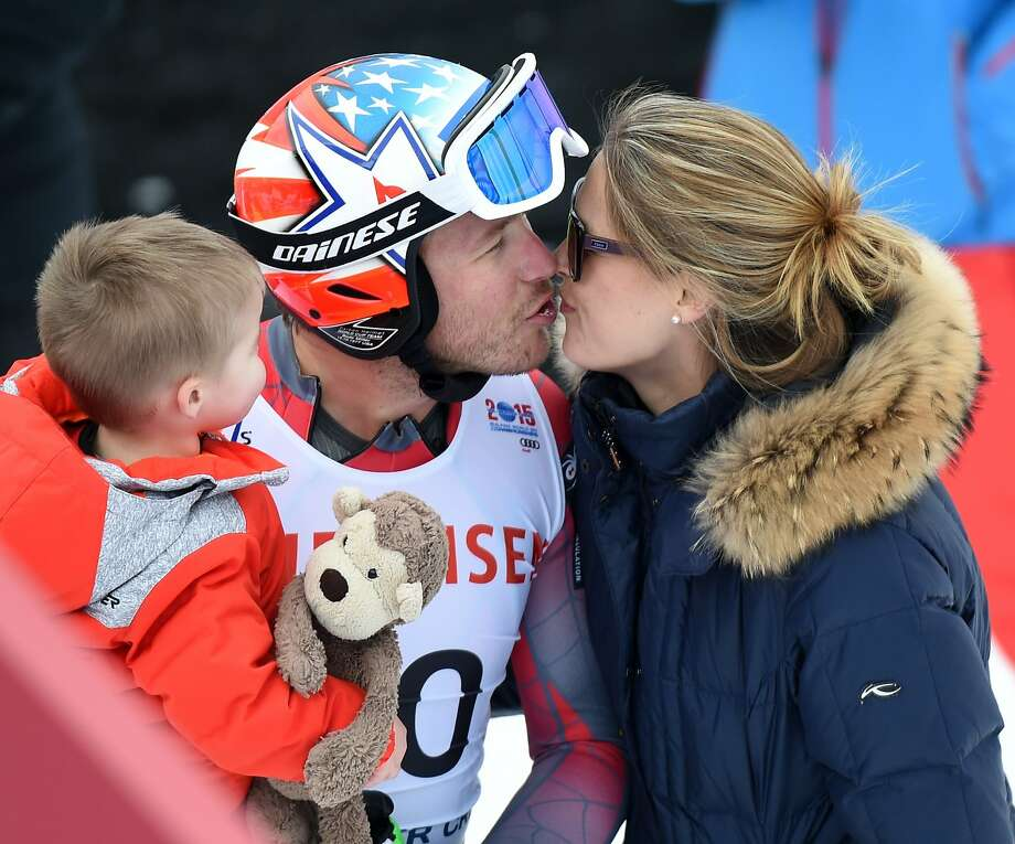 Bode Miller of the US gets a kiss from his wife Morgan Beck-Miller while holding his son in the finish area after the 2015 World Alpine Ski Championships men's downhill training February 3, 2015 in Beaver Creek, Colorado. Photo: Mark Ralston, AFP / Getty Images