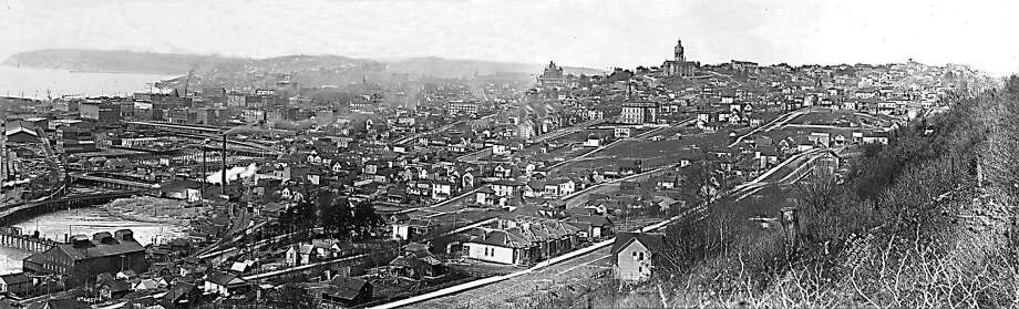 Downtown at the time:The view of Seattle from Beacon Hill looking toward Elliott bay.  Photographed in 1898. Photo courtesy of Museum of History and Industry. This image was published in a 1997 edition of the Seattle Post-Intelligencer. Photo: MUSEUM OF HISTORY AND INDUSTRY, Seattle Post-Intelligencer Archive, As Preserved By The Museum Of History & Industry