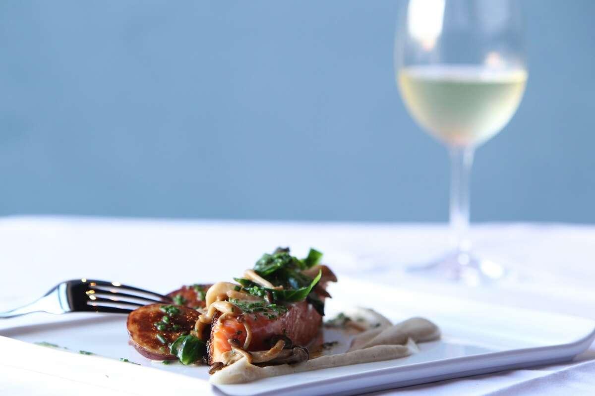Seared salmon, roasted potatoes, vanilla turnip mousseline, mushrooms & lemon beurre blanc at Étoile Cuisine et Bar Thursday, Oct. 25, 2012, in Houston. ( James Nielsen / Chronicle )