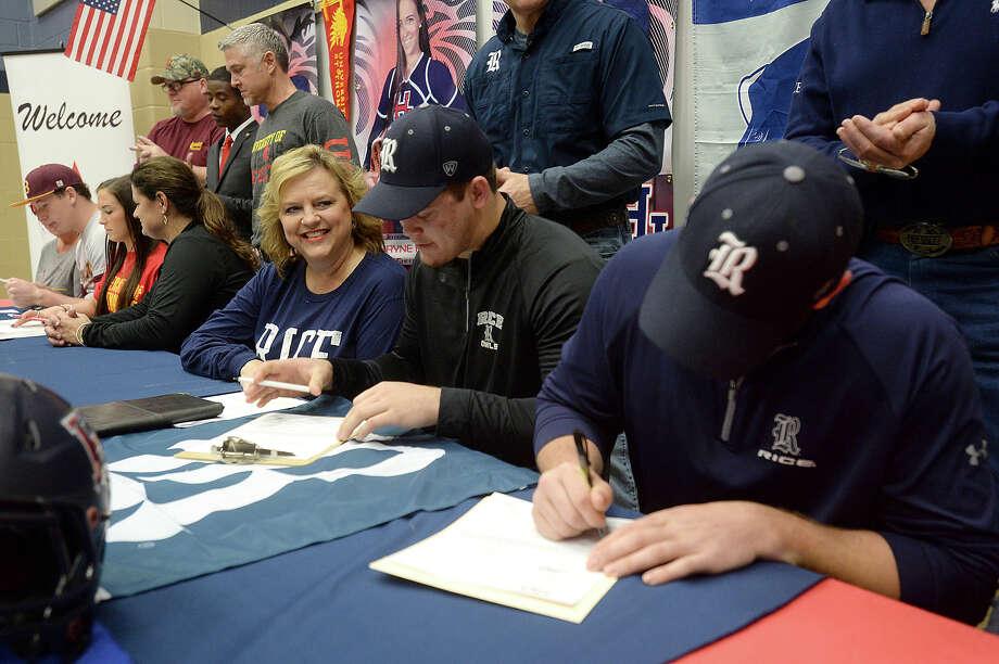 Wyndi Padgett looks on as her son Blain signs with Rice, as did teammate Roe Wilkins (right) at Hardin-Jefferson on national college football signing day Wednesday morning. Photo taken Wednesday, February 4, 2015 Kim Brent/The Enterprise Photo: Kim Brent / Beaumont Enterprise