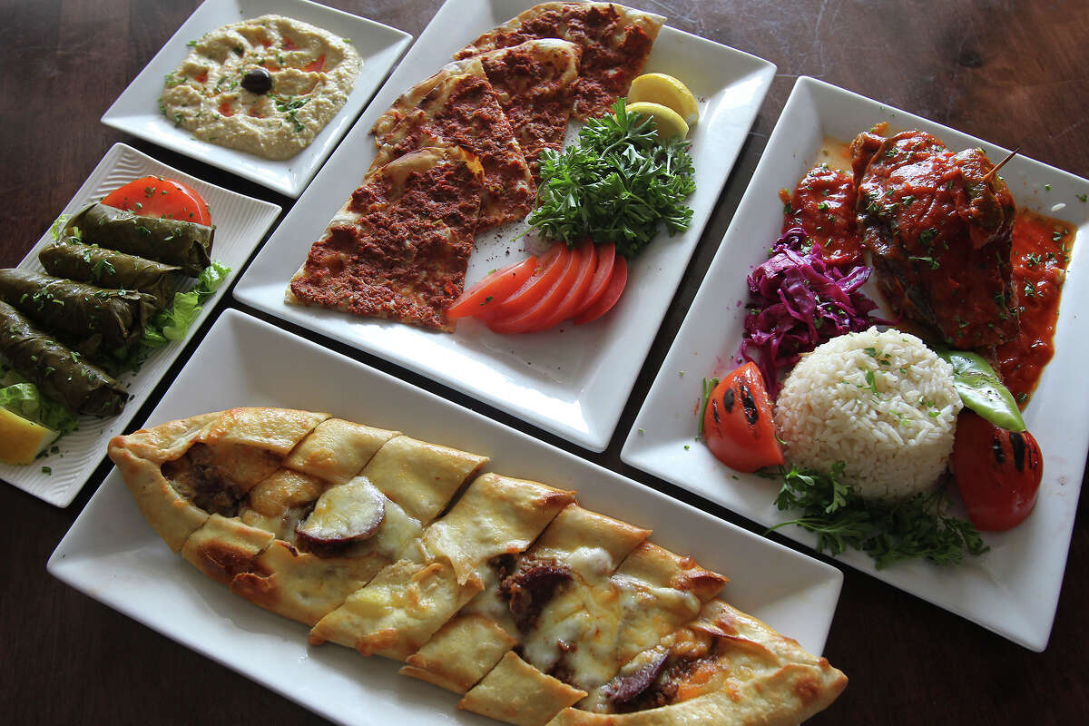 Mediterranean Turkish Grill prepares a Lahmacun plate and a lamb shank plate with appetizers.