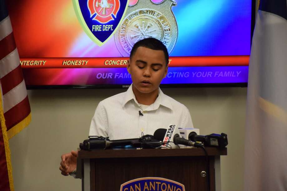 The San Antonio Fire Department honored 12-year-old Jacob Muñoz, who ran through his burning house Jan. 15 and saved his family, Wednesday morning. Photo: Mark D. Wilson