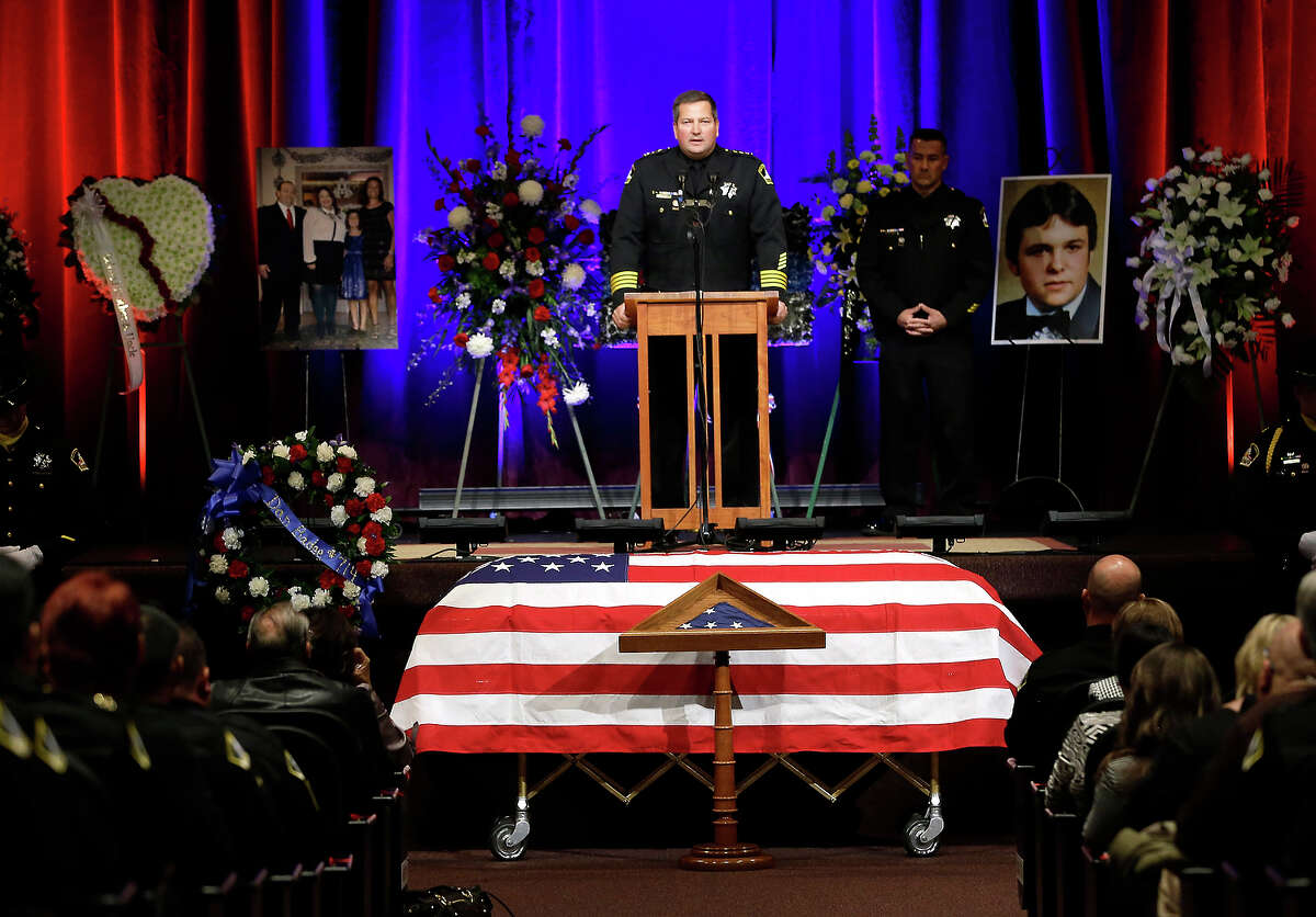 FILE-- Sacramento County Sheriff Scott Jones speaks at the memorial service for slain Sacramento County Deputy Danny Oliver, in Roseville, Calif. Monday, Nov. 3, 2014. Oliver and Placer County Sheriff's Detective Michael Davis Jr. were shot and killed in a shooting spree that spanned two Northern California counties, Oct. 26. Luis Enrique Monroy-Bracamonte, who was booked into the Sacramento County jail under the pseudonym Marcelo Marquez, faces murder charges in the killing of the two deputies, and the wounding of another deputy and a bystander.