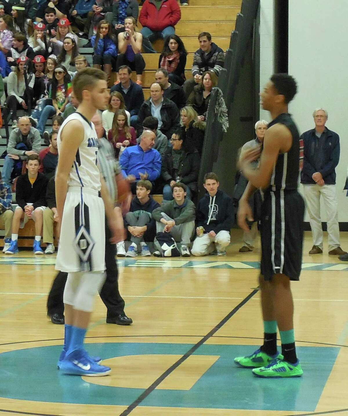 """6' 7"""" centers Alex Preston (left) and Kwe Askew get set for the jump ball in last Friday's game betwen Darien and Stamford. Askew had 14 points, Preston had 12."""
