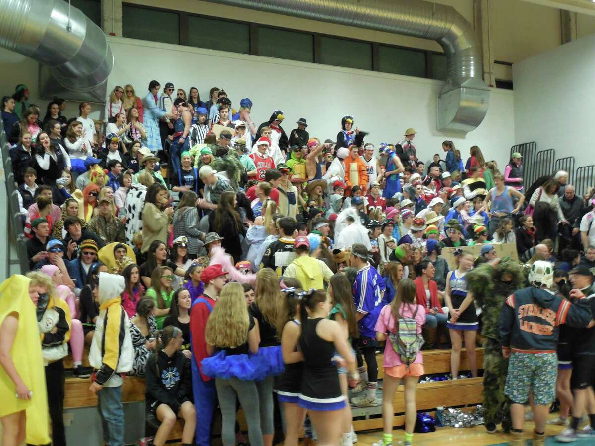 A raucous Darien crowd gets set to watch the game in their costumes.