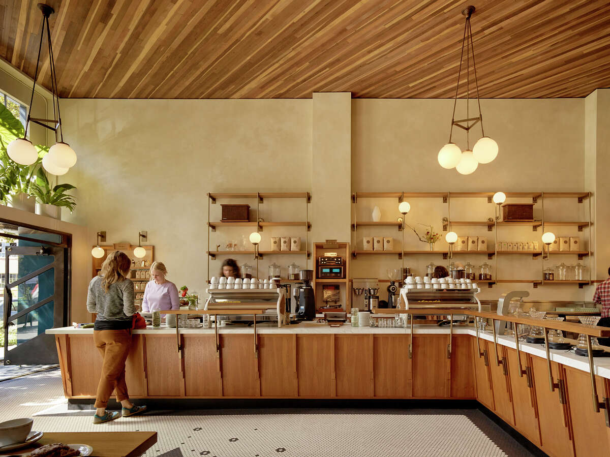 """Unlike Sightglass on Seventh Street, which is geared toward production, the 20th street location is a much more delicate space. """"We designed it with an old European feel and wanted to make it a comfortable space for the neighborhood to enjoy,"""" says co-founder Justin Morrison, who worked closely with the architects."""