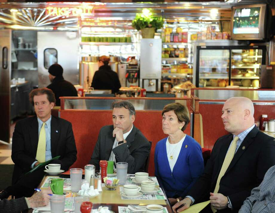 From left, State Sen. L. Scott Frantz, State Rep. Fred Camillo, State Rep. Livvy Floren, and State Rep. Mike Bocchino listen attentively during the community forum at Glory Days Diner in Greenwich, Conn. Wednesday, Feb. 4, 2015.  State Sen. L. Scott Frantz, State Rep. Livvy Floren, State Rep. Fred Camillo and State Rep. Mike Bocchino joined Greenwich residents and entrepreneurs in a casual setting at the diner to gain a community perspective and answer questions about local and state-wide issues. Photo: Tyler Sizemore / Greenwich Time