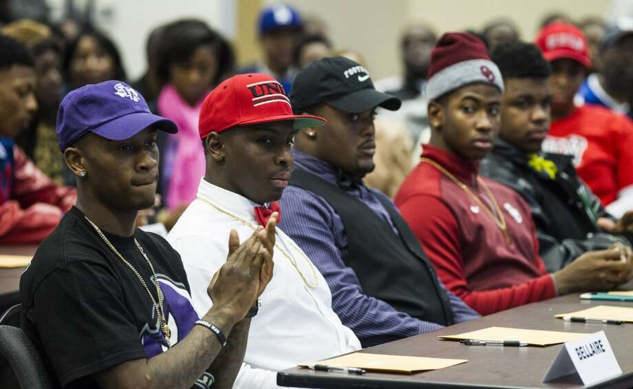 Bellaire High School football players, from left, Travon Smith, Stephen F. Austin, Xzaniar Campbell, UNLV, Elvis Davis, Texas College, and basketball player Christain James, Oklahoma, listen to the speakers during the Houston Independent School District National Signing Day ceremony at Region IV Education Service center on Wednesday, Feb. 4, 2015, in Houston. ( Brett Coomer / Houston Chronicle ) Photo: Brett Coomer, Houston Chronicle