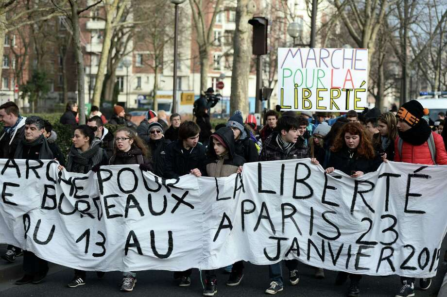 Demonstrators march from the Hyper Casher shop in Vincennes, a Paris suburb, toward the satirical newspaper Charlie Hebdo offices in Paris, two weeks after the attacks that left 16 dead.  A reader expresses disappointment that President Obama did not travel to France to show his support for the demonstrators. Photo: Stephane De Sakutin /AFP / Getty Images / AFP