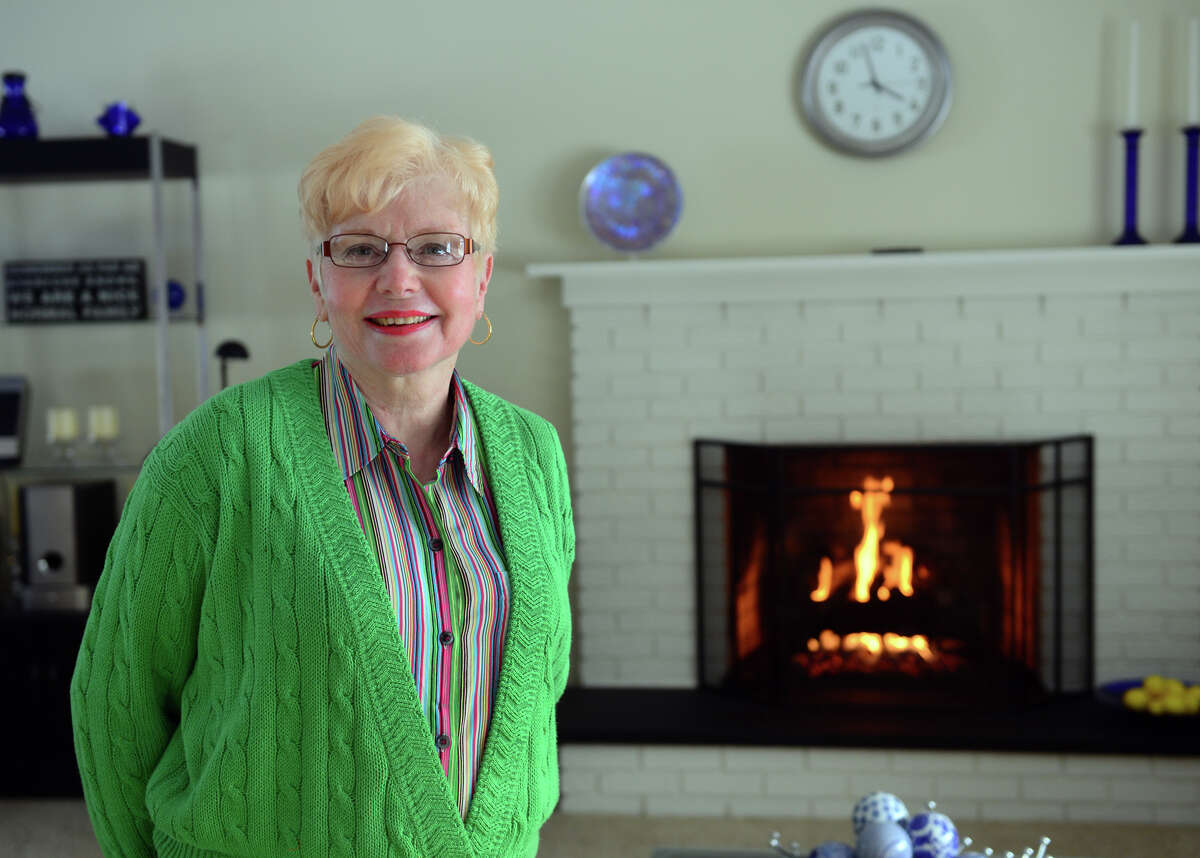 Gail Zorpette, who worked for GE for almost 30 years, poses at her home in Stratford, Conn. on Wednesday Feb. 4, 2015. Zorpette was told that she and other retirees would have their health benefits cut.