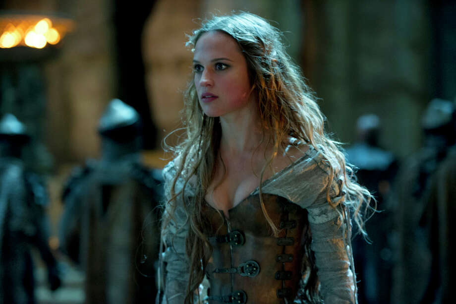 "The witch Alice (Alicia Vikander) may not be exactly what she seems in the fantasy ""Seventh Son,"" which is based on the novel. Photo: Kimberly French / Associated Press / Universal Pictures"