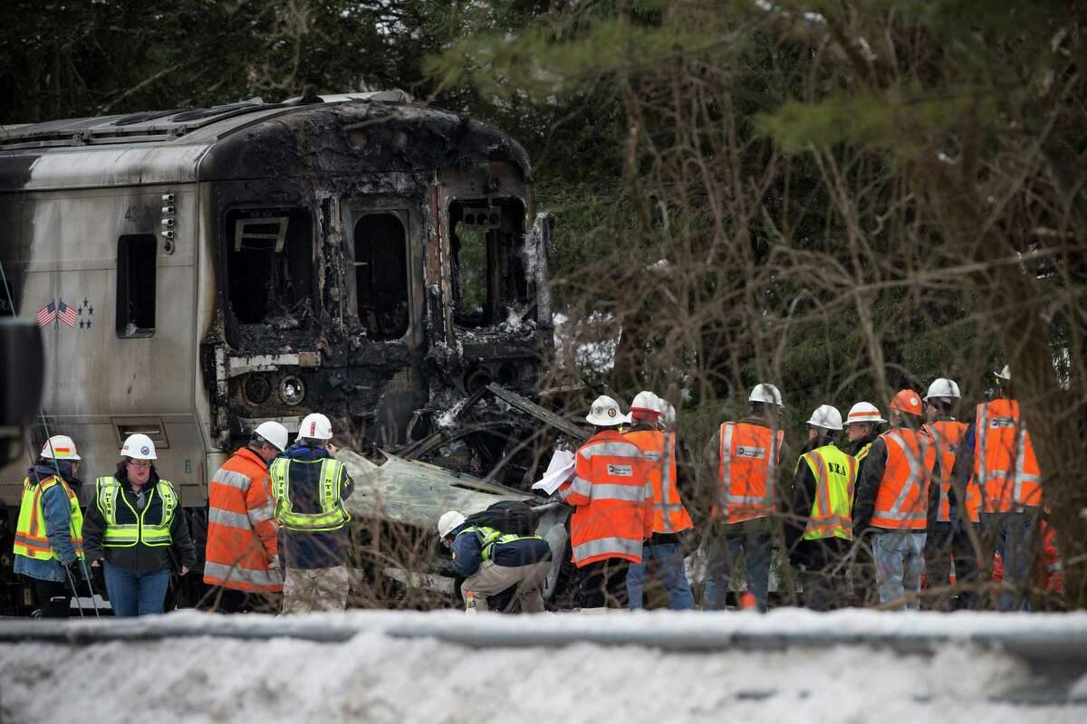 VALHALLA, NY - FEBRUARY 04: Officials inspect a Metro-North train crash with a sport utility vehicle that occured last night on February 4, 2015 in Valhalla, New York. The crash started a fire in the train cars that killed six people, including the driver of the vehicle.
