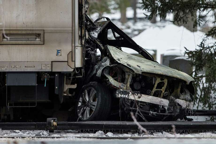 VALHALLA, NY - FEBRUARY 04:  Officials inspect a Metro-North train crash with a sport utility vehicle that occured last night on February 4, 2015 in Valhalla, New York. The crash started a fire in the train cars that killed seven people, including the driver of the vehicle. Photo: Andrew Burton, Getty Images / 2015 Getty Images